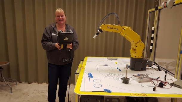 wanda-waldrop-operating-robotic-arm-in-the-manufacturing-department