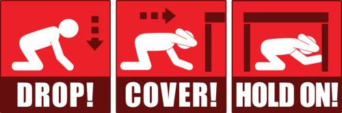 "A graphic shows a stick figure kneeling, covering their head and neck with their arm, finding cover under a desk, and holding on to the desk leg for support. Text reads ""Drop! Cover! Hold on!"""