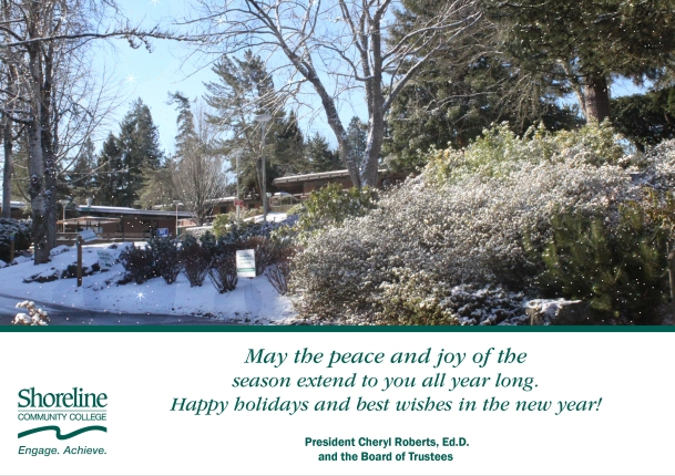 """A photo of trees in the campus courtyard covered in snow. Beneath the photo, text reads: """"May the peace and joy of the season extend to you all year long. Happy holidays and best wishes in the new year!"""" Signed, President Cheryl Roberts, Ed.D. and the Board of Trustees"""