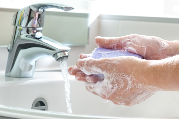 hands washing with soap and water